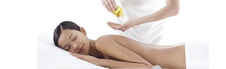 Woman receiving a spa back massage with Body Treatment Oil