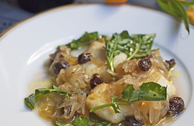 Sweet and sour halibut, raisins, and watercress